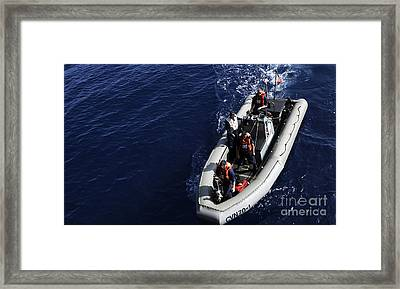 Sailors Stand Watch On A Rigid-hull Framed Print by Stocktrek Images