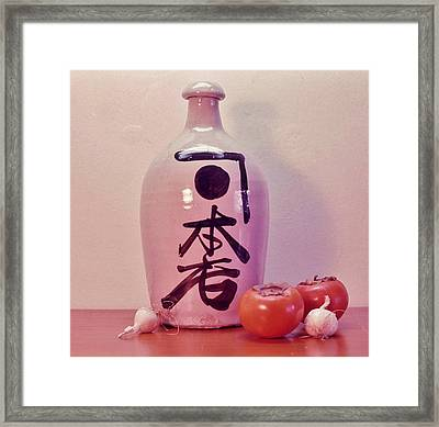 Framed Print featuring the photograph Sake Jug With Persimmon And Garlic by Craig Wood
