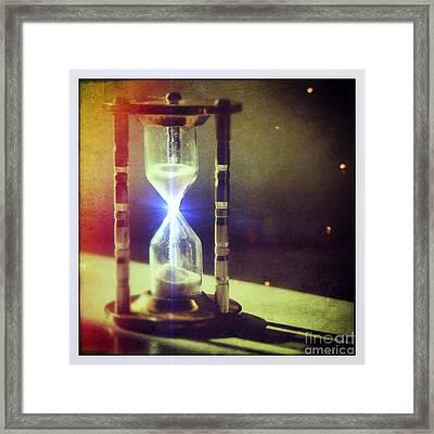 Sand Through Hourglass Framed Print