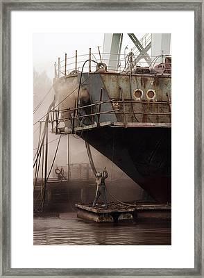 Sandblasters Restore A Soviet Ship Framed Print by Cotton Coulson