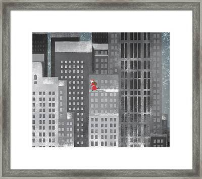 Santa Clause Running On A Skyscraper Framed Print by Jutta Kuss