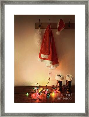 Santa Costume Hanging On Coat Hook With Christmas Lights Framed Print