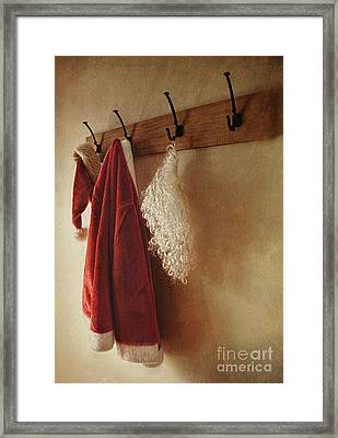 Santa Costume Hanging On Coat Rack Framed Print by Sandra Cunningham