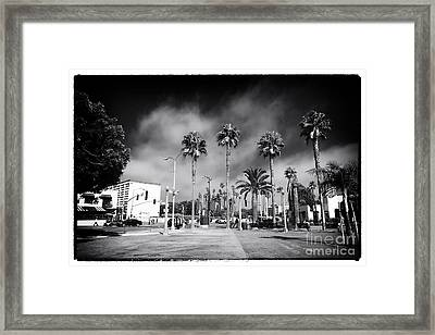 Santa Monica Walking Framed Print by John Rizzuto
