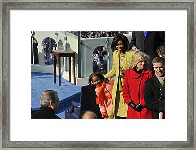 Sasha Obama Peeks Around Her Mother Framed Print