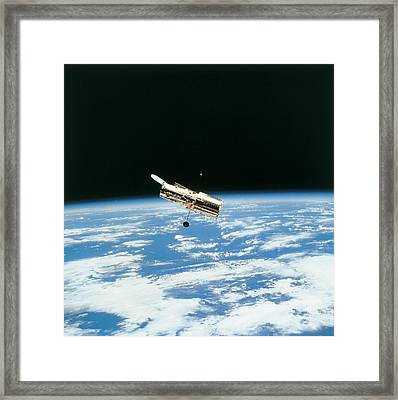Satellite In Orbit Above Earth Framed Print by Stockbyte