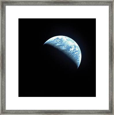 Satellite View Of A Partially Hidden Earth Framed Print by Stockbyte