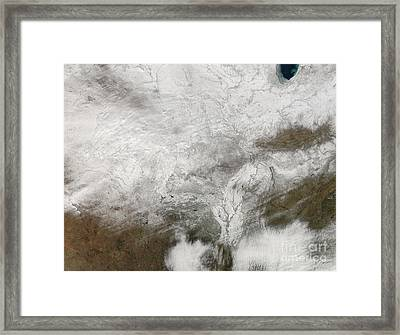Satellite View Of A Severe Winter Storm Framed Print by Stocktrek Images