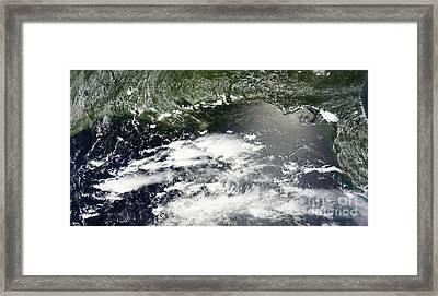 Satellite View Of Oil Leaking Framed Print by Stocktrek Images