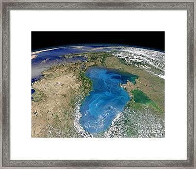 Satellite View Of Swirling Blue Framed Print by Stocktrek Images