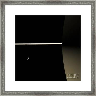 Saturn And Its Moon Tethys Framed Print by NASA/Science Source