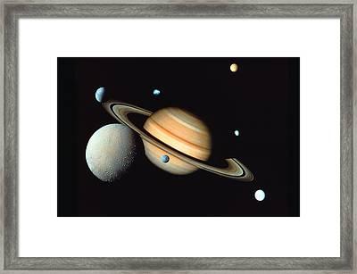 Saturn And Satellites Framed Print by John Foxx