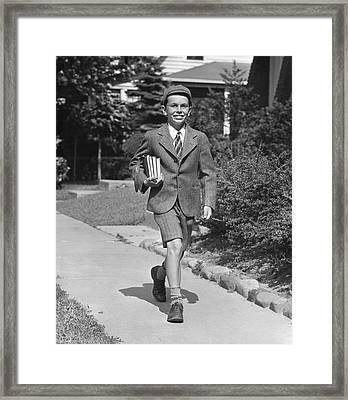Schoolboy On Sidewalk Framed Print by George Marks
