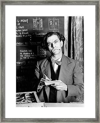 Scientist By Blackboard Covered In Equations (b&w) Framed Print by Hulton Archive