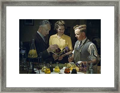 Scientists Examine Results Of Tests Framed Print by B. Anthony Stewart