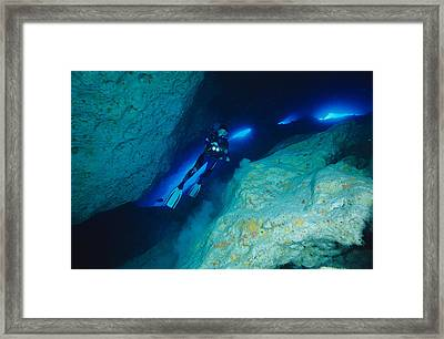 Scuba Diver In A Cave Framed Print