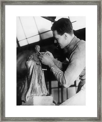Sculptor Changing The Head Of A Statue Framed Print