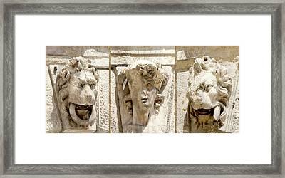 Sculptured Heads Framed Print