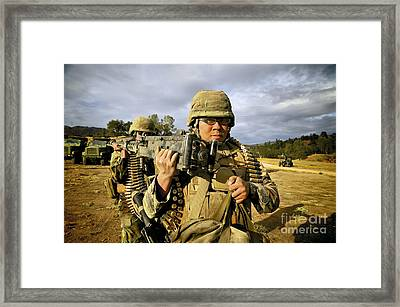 Seabees Carrying A 50-caliber Machine Framed Print by Stocktrek Images