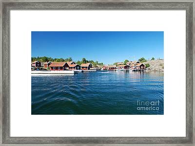 Seaside Red Cottage Framed Print by Conny Sjostrom