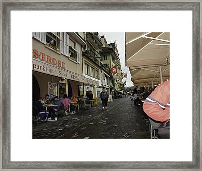 Seated In The Cafe Along The River In Lucerne In Switzerland Framed Print by Ashish Agarwal