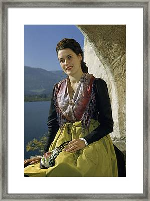 Seated Woman Wears Dirndl Skirt Framed Print by Volkmar Wentzel