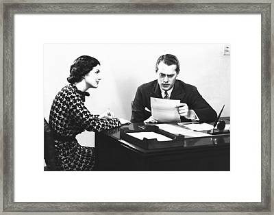 Secretary Assisting Businessman Reading Document At Desk, (b&w) Framed Print by George Marks