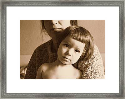 Secure In Mom's Arms Framed Print by Ion vincent DAnu