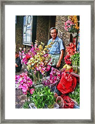 Selling Flowers In Chinatown Framed Print by Anne Ferguson