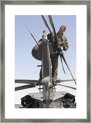 Sergeant Inspects An Hh-60 Pave Hawk Framed Print by Stocktrek Images