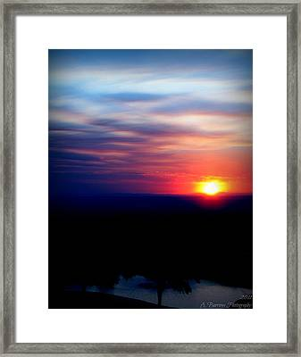 Setting Over The Pond Framed Print by Aaron Burrows