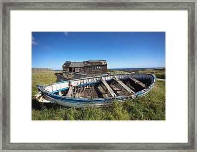 Shack And Broken Boat Framed Print by John Short