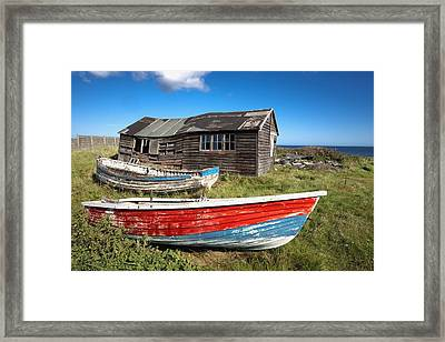 Shack And Old Boats Framed Print by John Short