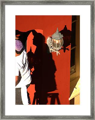 Shadow Painter Framed Print