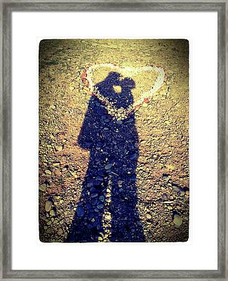 Shadows Of Couple Kissing Over Heart Of Stones Framed Print by Daniel MacDonald / www.dmacphoto.com