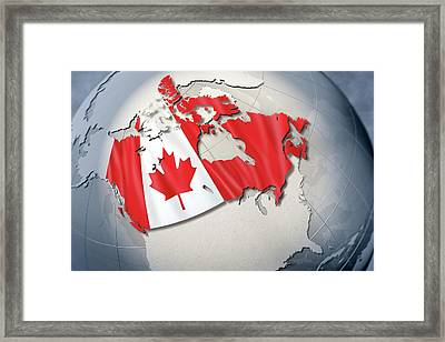 Shape And Ensign Of Canada On A Globe Framed Print