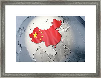 Shape And Ensign Of China On A Globe Framed Print by Dieter Spannknebel