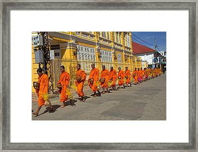 Sharing Food With Buddhist Monks  Framed Print by Nabil Kannan