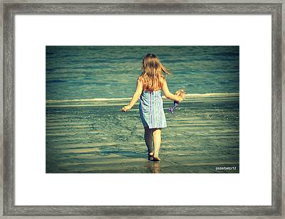 She Lives At Sea She Plays In The Sand Framed Print by Paulo Zerbato