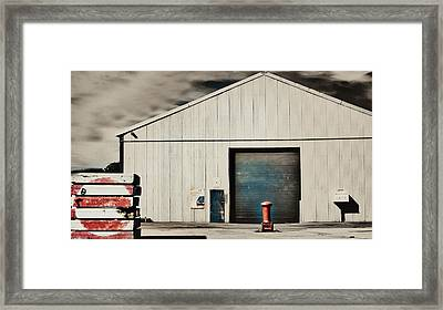 Shed With Bollard And Pallets Framed Print by Harry Neelam
