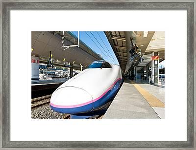 Shinkansen At Tokyo Station Framed Print by Ulrich Schade