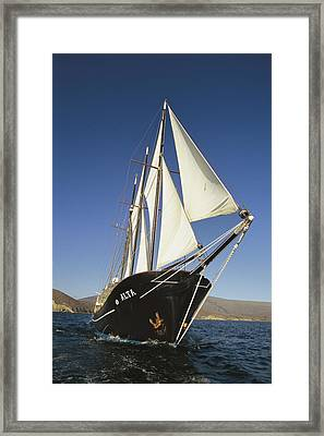 Ship Sailing Through The Galapagos Framed Print by Steve Winter