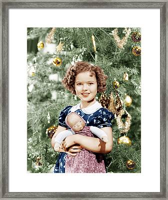 Shirley Temple Holding Doll Framed Print by Everett