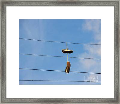 Shoes Hanging From Power Line Framed Print by David Buffington