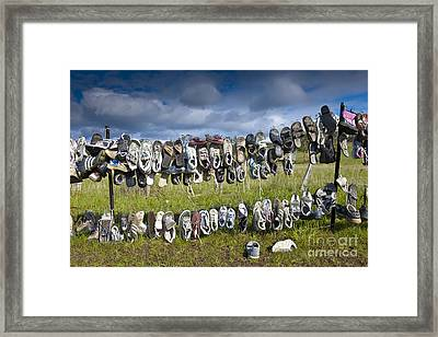 Shoes Hanging On Fence Framed Print by Jacobs Stock Photography