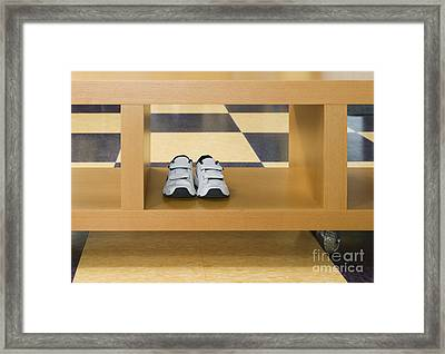 Shoes In A Shelving Unit Framed Print
