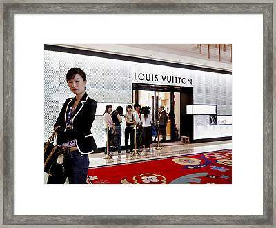 Shoppers Await Entry Into The Louis Framed Print by Justin Guariglia