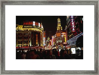 Shoppers On Nanjing Lu, A Popular Framed Print by Justin Guariglia