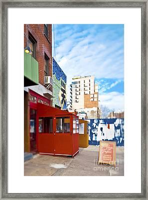 Shops On A City Street Framed Print by Eddy Joaquim