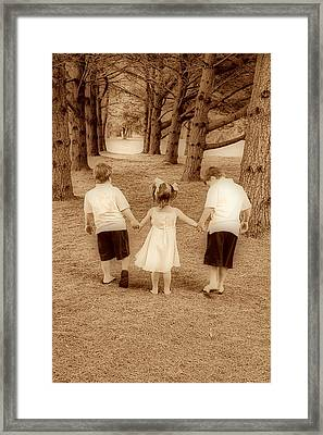 Siblings Taking A Walk Framed Print by Trudy Wilkerson